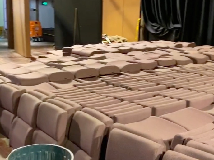 The seating pads and backs were neatly stacked on the stage